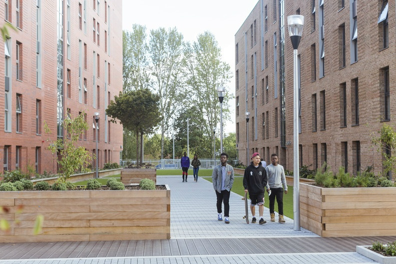 Students on campus at the University of Salford
