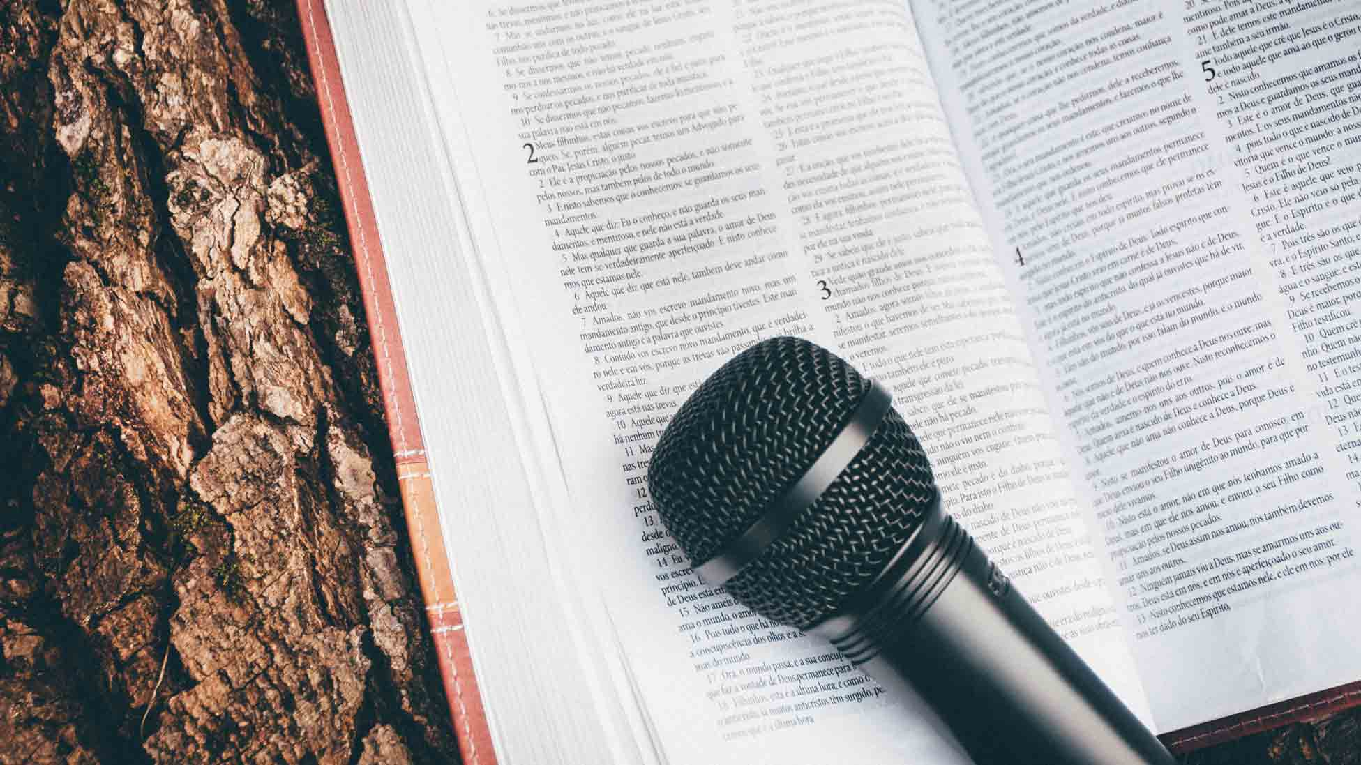 Microphone resting on pages of book